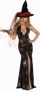 Сексапильная колдунья в черном платье в пол с разрезом